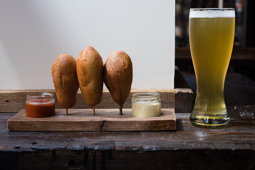 House-smoked corndogs served with a whole-grain mustard aioli and house-made ketchup and a german kolsh to wash it all down. (Dustin Franz/The Washington Post)