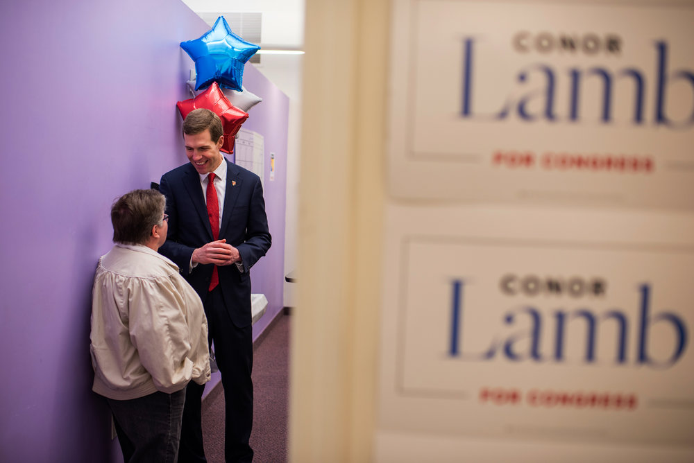 Conor Lamb, the democratic congressional candidate for Pennsylvania's 18th district, talks with a supporter at his campaign headquarters in Carnegie, Pennsylvania on Friday, Feb. 18, 2018. Dustin Franz for The New York Times