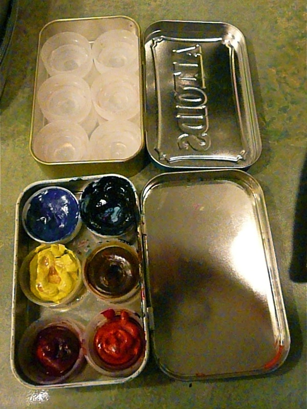 Altoids can, the paint is squeezed into water bottle lids - stick with red, blue, yellow and one darker and another of your favorite color.
