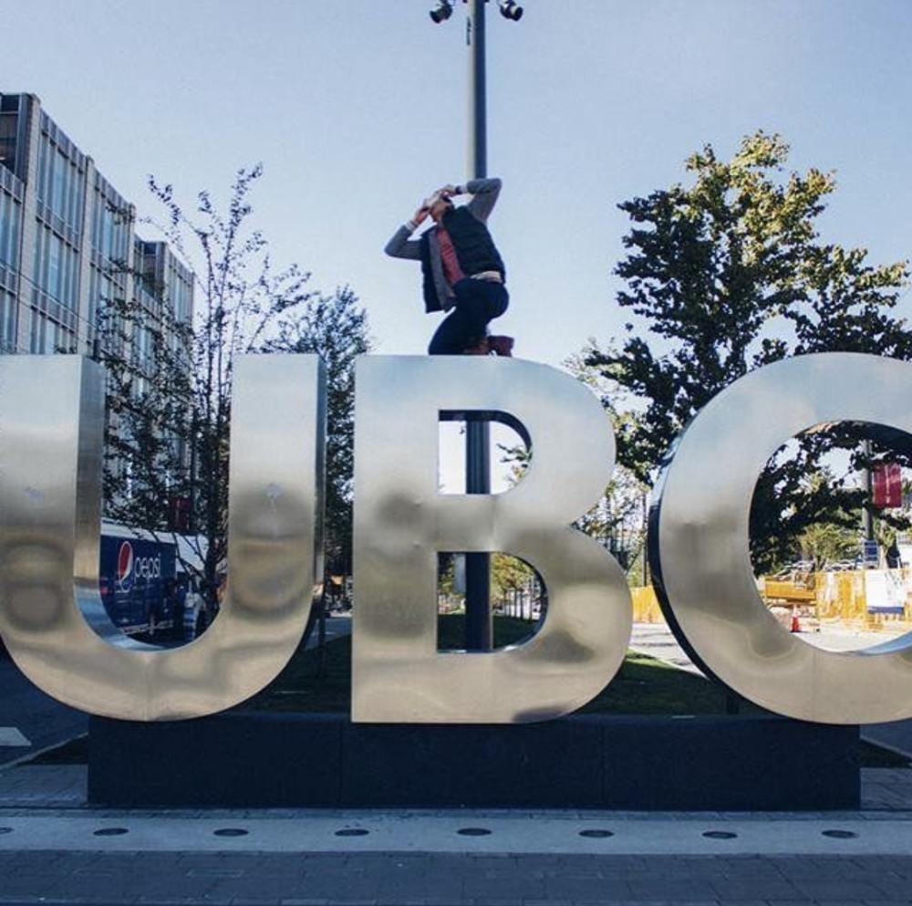 Brother Tri Tran (PA '12) shotguns a celebratory non-alcoholic beverage atop UBC's famous letters in University Blvd.