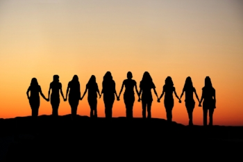 women-holding-hands-sunrise-silhouette-641949.jpg