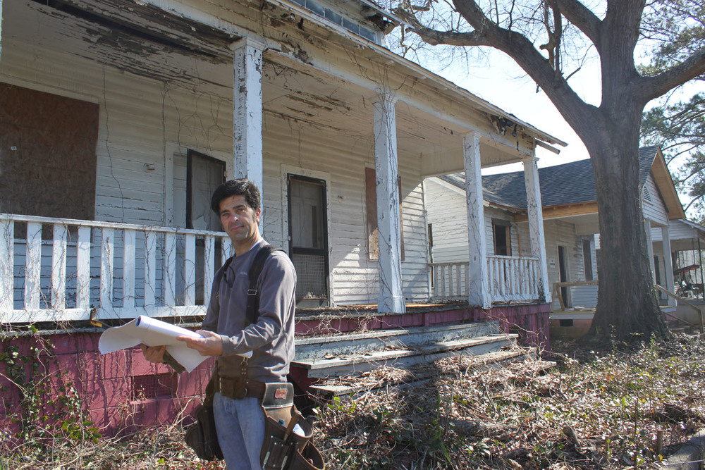 Michael Phillips, Historic Macon's Preservation Carpenter, prepares for work in Mill Hill
