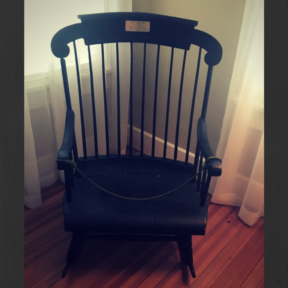 The abnormally large rocking chair of the Sidney Lanier Cottage.