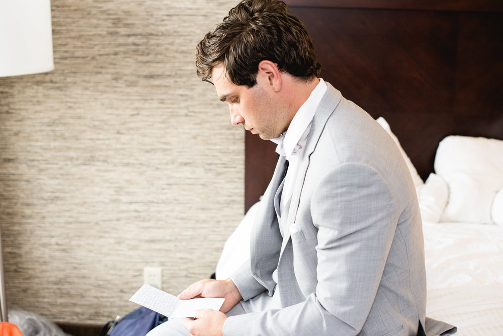 Groom reading note in hotel