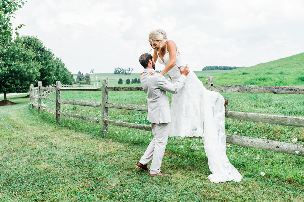 bride jumps from fence Armstrong Farms Wedding Venue