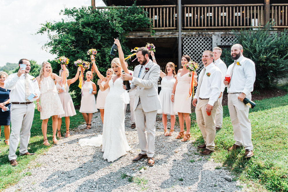 bride and groom celebrate at Armstrong Farms Wedding Venue