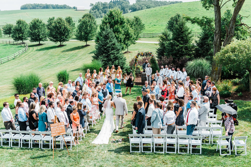 bride walks down aisle at Armstrong Farms Wedding Venue