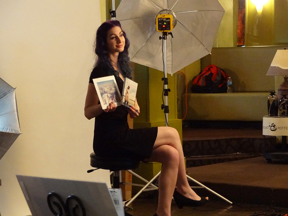 Geena Matuson posing for promotional photos at RAW Artists 'Revolution' event, May 2014.