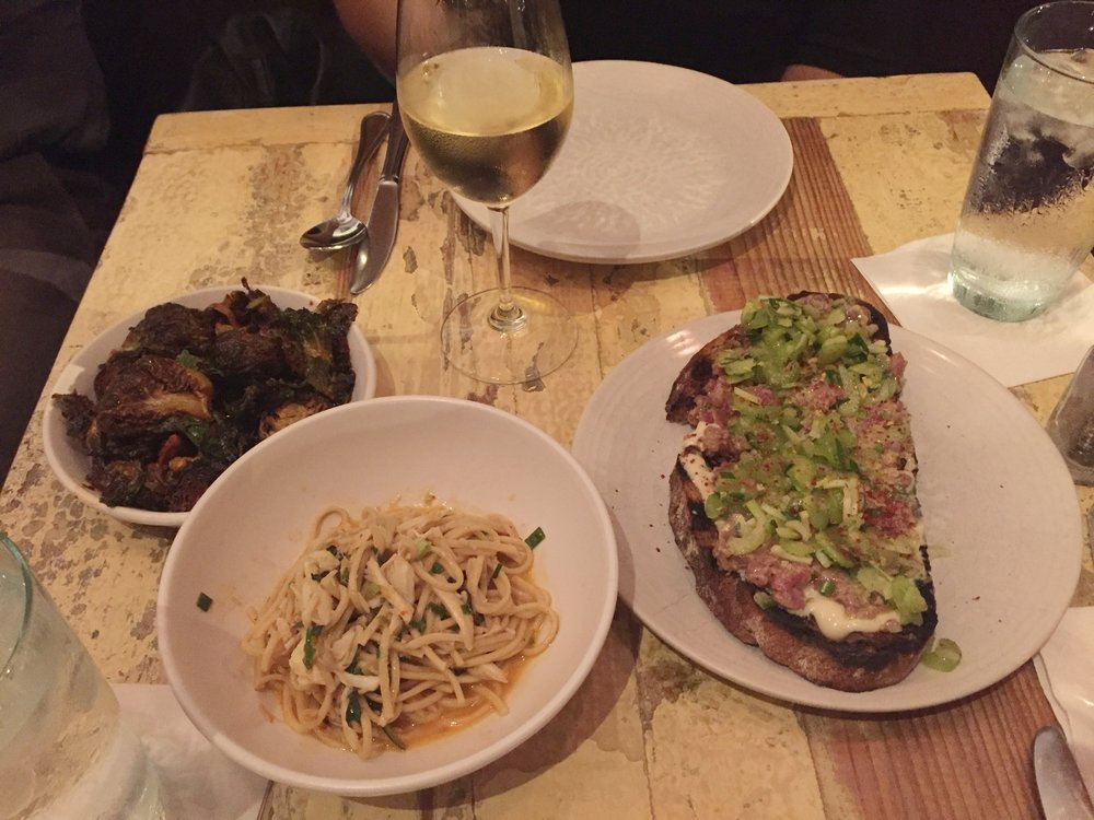 Fried brussels sprouts with chilli vinegar, crab and jalapeno capellini, and the steak tartare with oyster aioli.