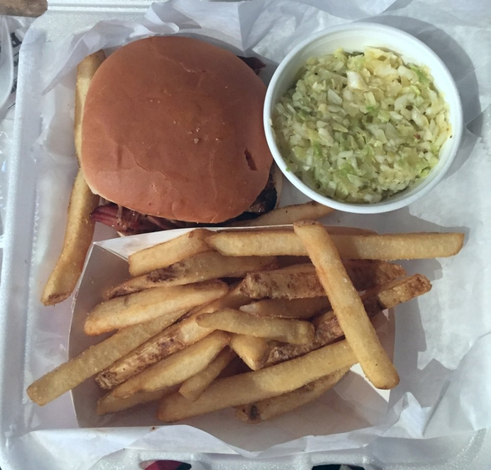 Pulled pork sandwich, with coleslaw, and fries at Saw's Soul Kitchen