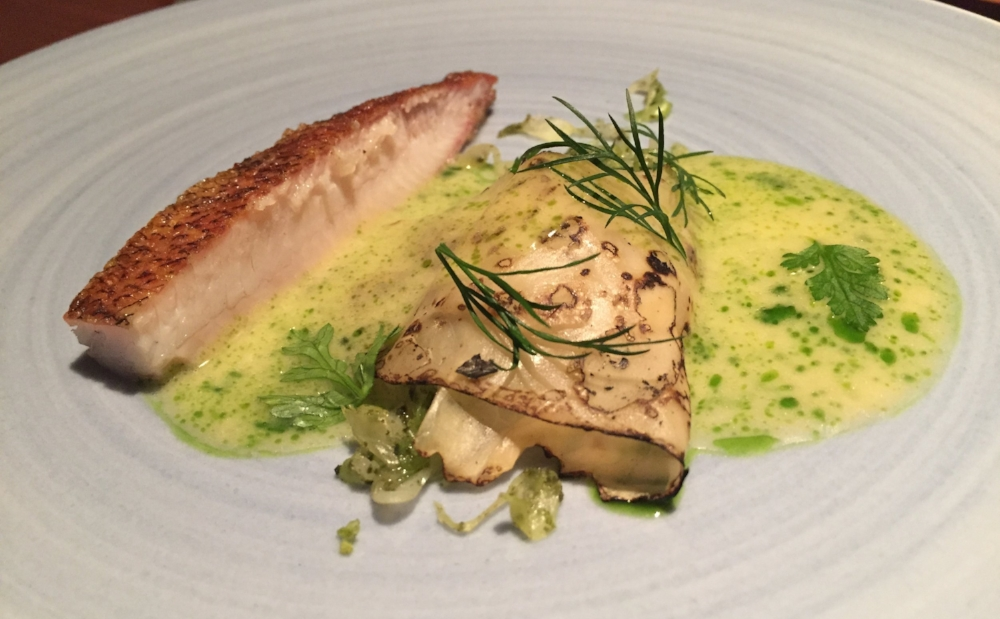 The perch served with fresh cabbage and algae