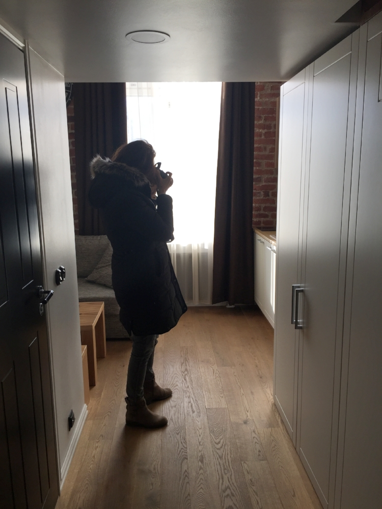 Carrie photographing the kitchen and living room.