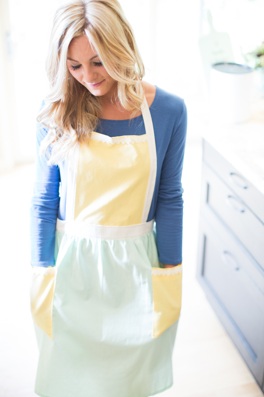 Alex is wearing Buttercream's limited edition apron and Cinnamon Swirl Swing Dress.