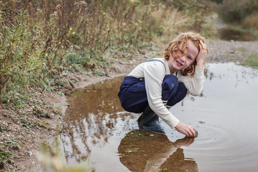 kid-playing-in-puddle-in-waterproof-rainpants.jpg