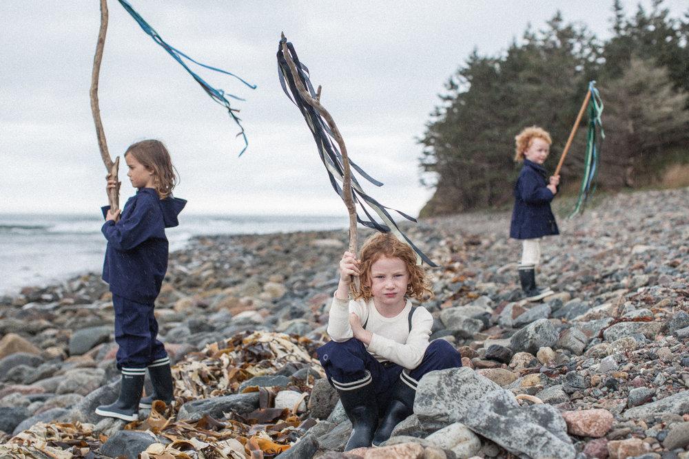 kids-wearing-waterproof-pants-and-raincoat-outerwear.jpg