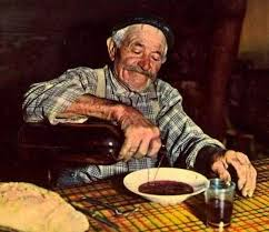 old man drinking wine