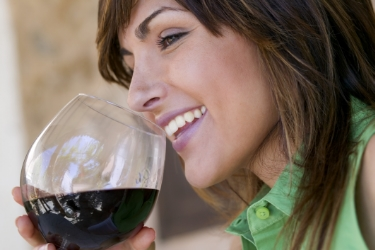 Smiling lady with glass of red wine