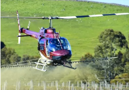 helicoptor sprating vineyard with chemicals