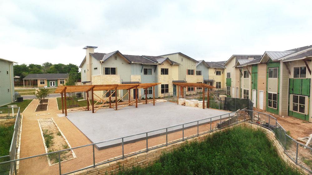 Main amenity courtyard & walkway to pool-side fitness club