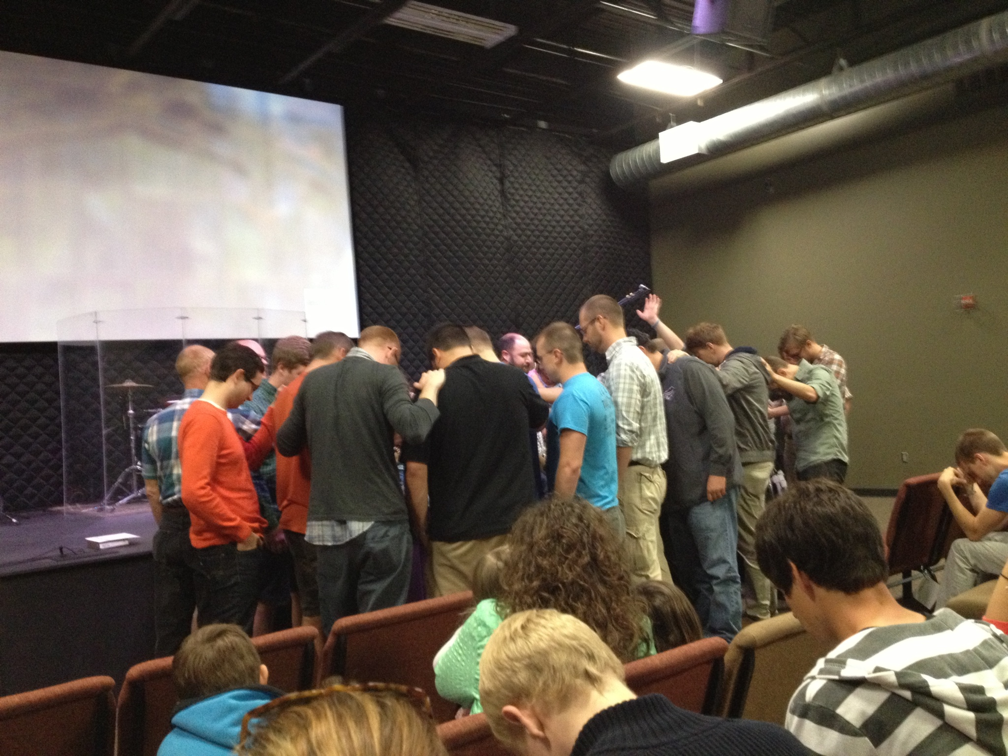 2 Pillars men praying over Adam, Callan, and I as well as the Sorilla family on Installation Sunday