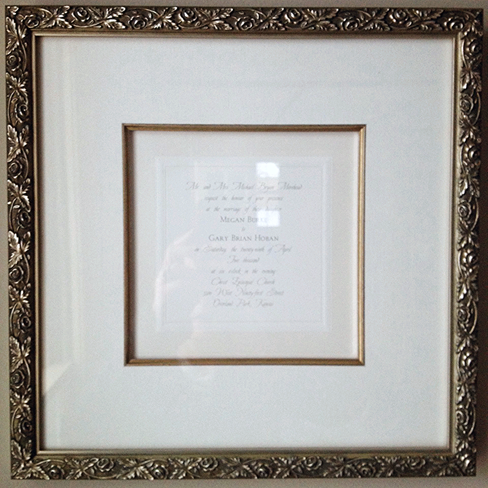 A wedding invitation in a beautiful frame is a lovely memento for the bride and groom to cherish the rest of their years together.
