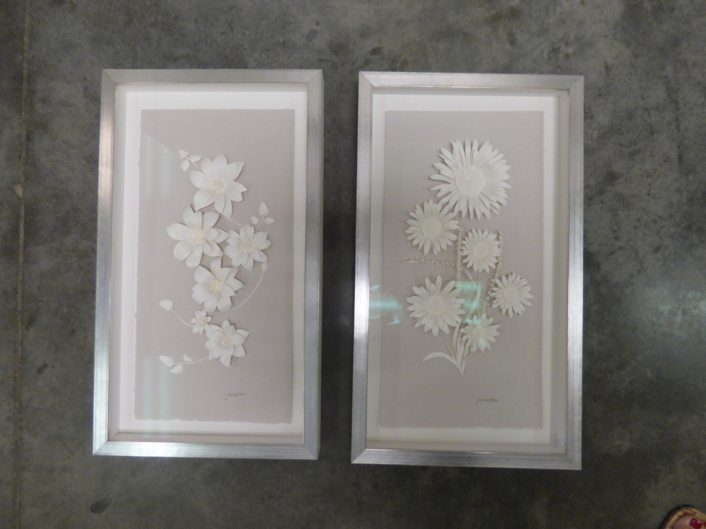 Two paper-art masterpieces came alive with this contemporary, sleek silver frame.