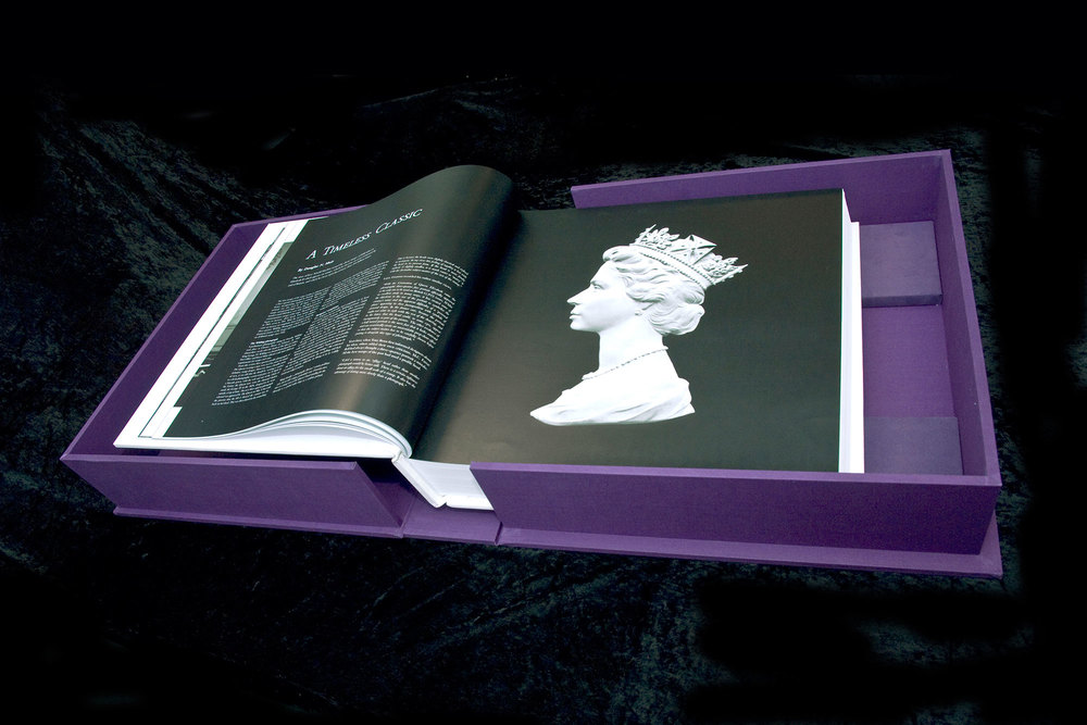 The book within it's lavish silk covered box, showing an image of the original cast of Queen Elizabeth II, which was used to create stamps and currency  . Book design by Martin Sully.