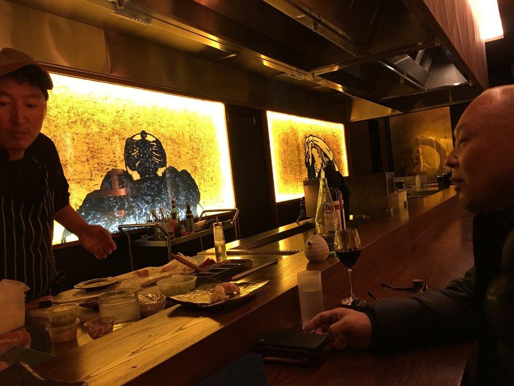 Tetsuya prepares sushi for a friend.