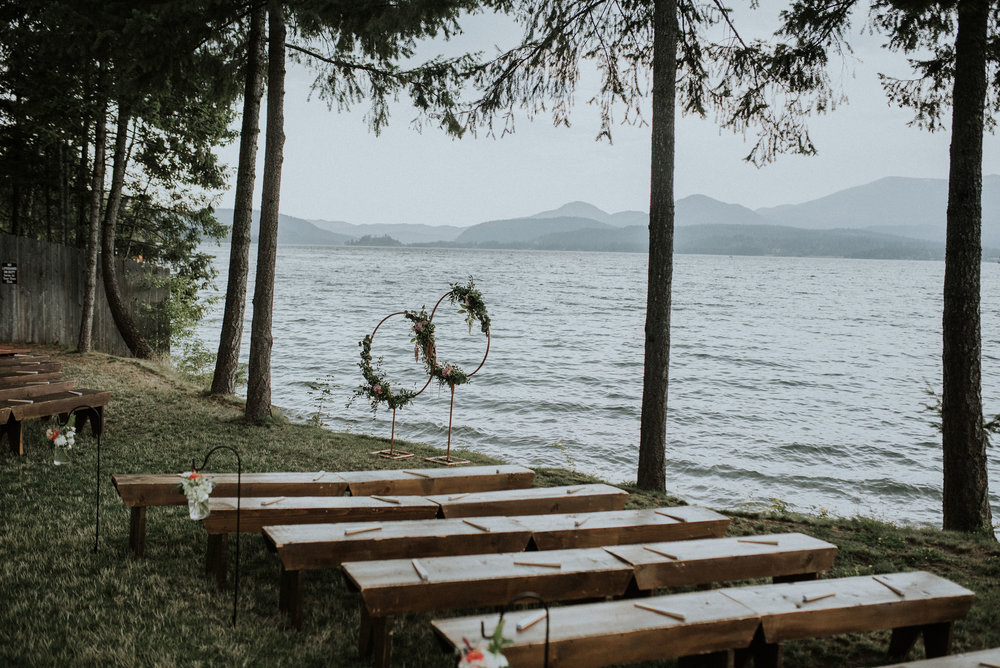 Lakeside ceremony with wood benches
