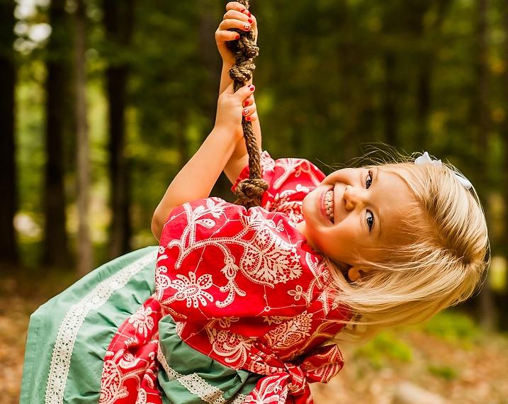 Lyla outside on rope swing!