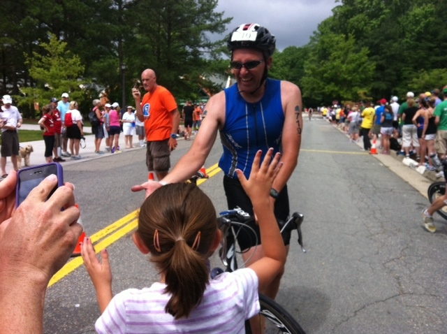 Friend, Jason Matthews, high fives his kids during the Williamsburg Half Iron Man race!