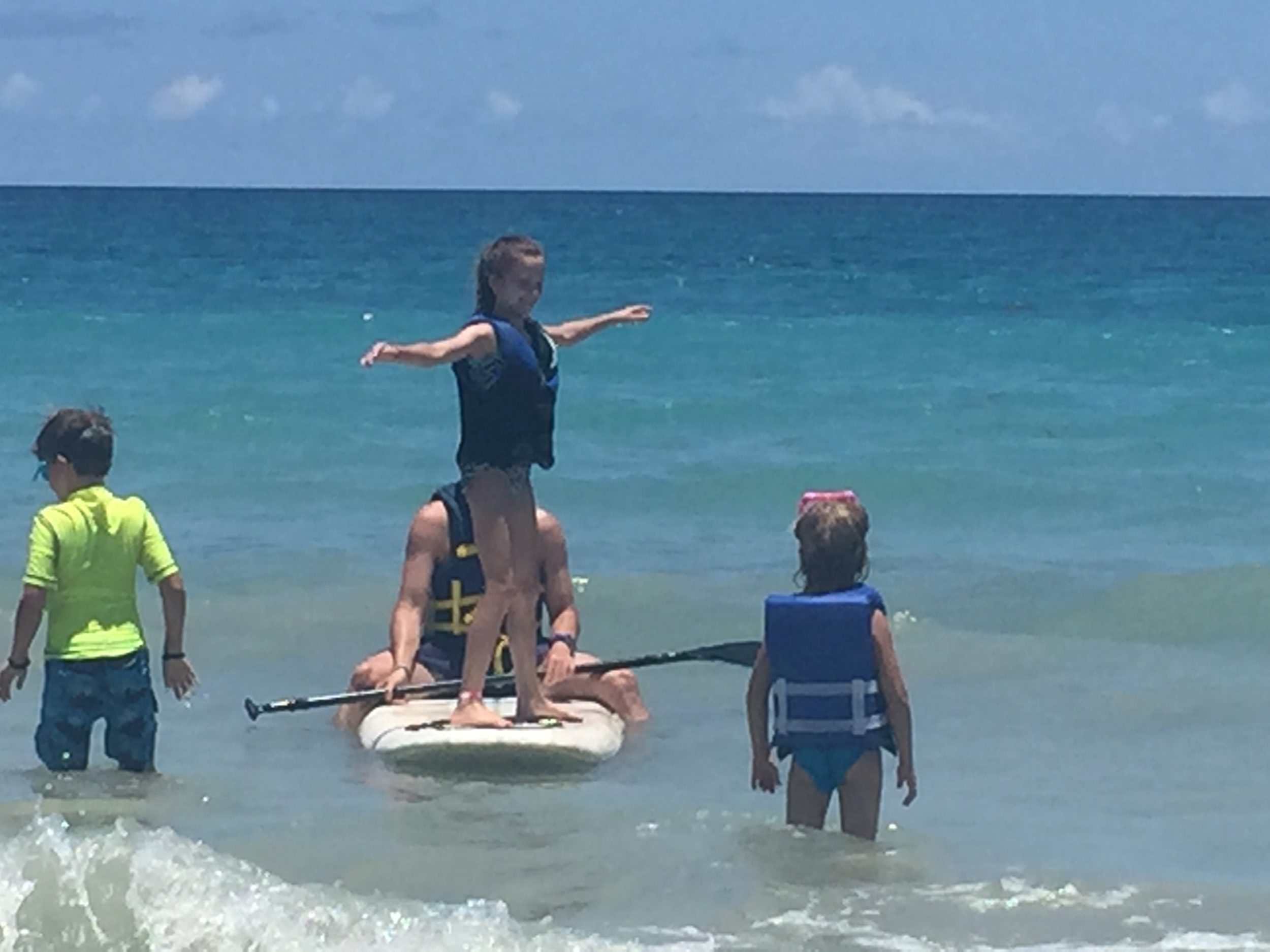 Kaitlyn trying her hand out paddleboarding!