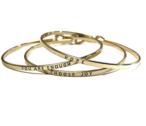 gold bracelets.jpg