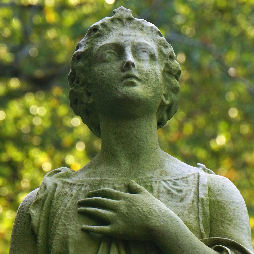 green background statue