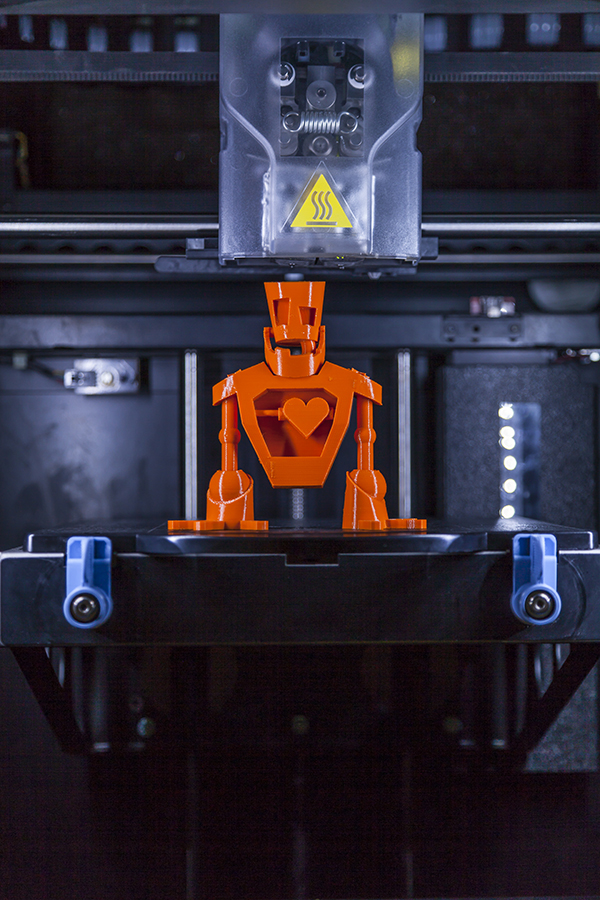A robot made on a 3D printer at NextFab studio | Photo by Addison Geary