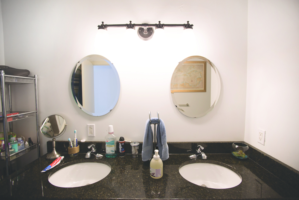 The shared bathroom space of Art Museum resident Krista Pfleger. Krista's sink is on the right.