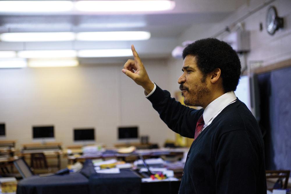 Teacher Jay Fluellen in his music classroom at Northeast High School