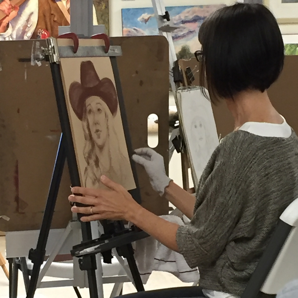 Artist Rita Kirkman at work on a portrait from life - Valentine Nebraska Art Workshop