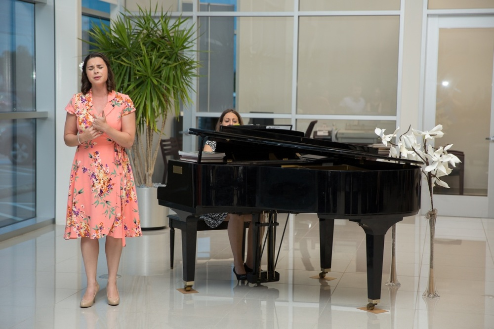 "Soprano Donata Cucinotta performed from ""I Pagliacci"" during Opera in the Heights' Overture! event at Tommie Vaughn Ford in the Heights, accompanied by Bethany Self. Photo by Carl Cramer"