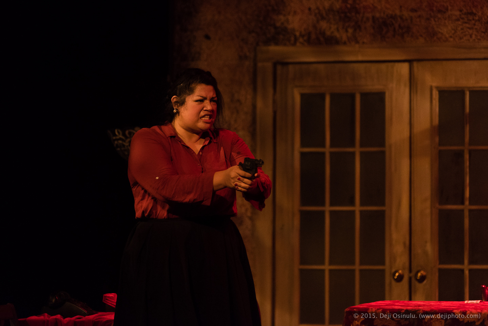 Mezzo-soprano Claudia Chapa packing heat as Madame Flora   in Opera in the Heights' THE MEDIUM.   © Deji Osinulu Photography