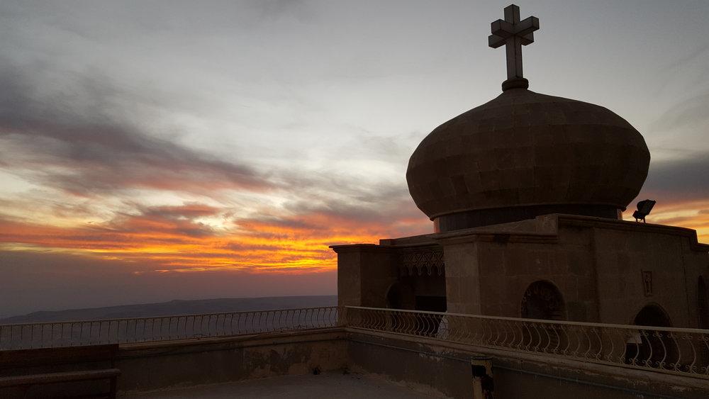The sun sets over Mosul, a view from the Mar Mattai Monastary in Nov. 2016. (Sarah Lawrynuik)