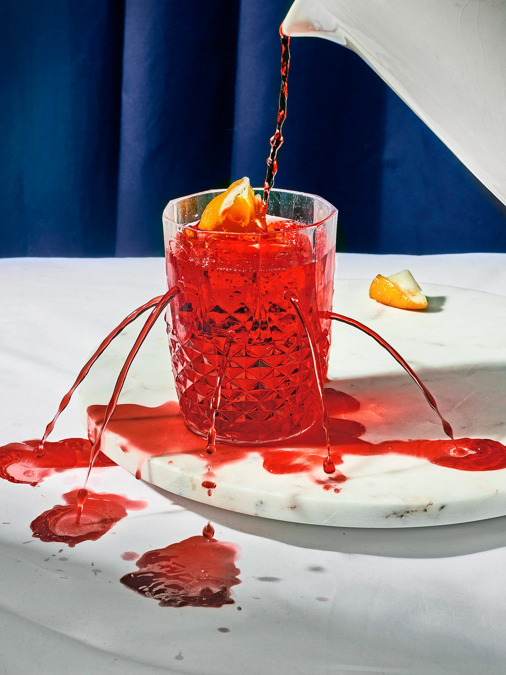 how to make a bottomless negroni. take an empty glass. full it half up. keep on filling it.   Photography & Art Direction: Henry Trumble