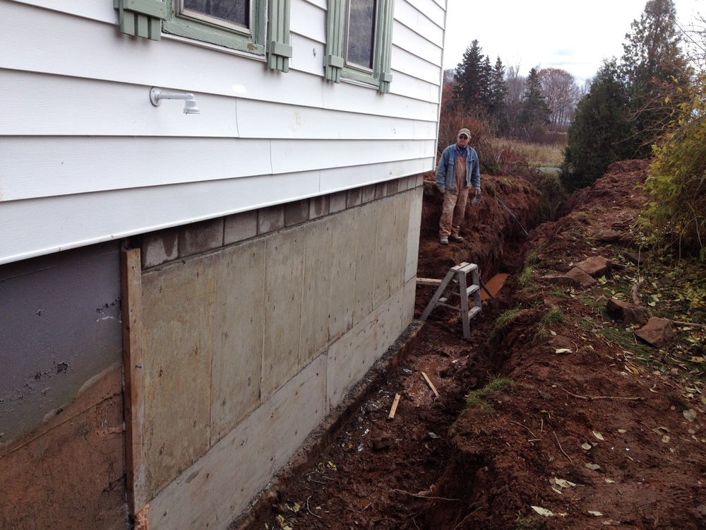 Boom! New basement and ripped up yard