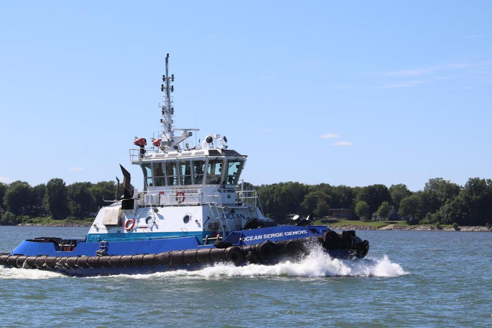 Passing river tug