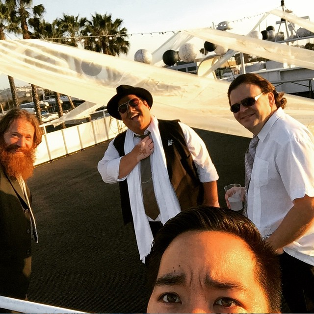 Graeme Hinde, Manny Decoria, Rich Smith, & Eric Volfango relaxing before Casual Encounters Live Band Karaoke performs at a wedding reception aboard the FantaSea One yacht.