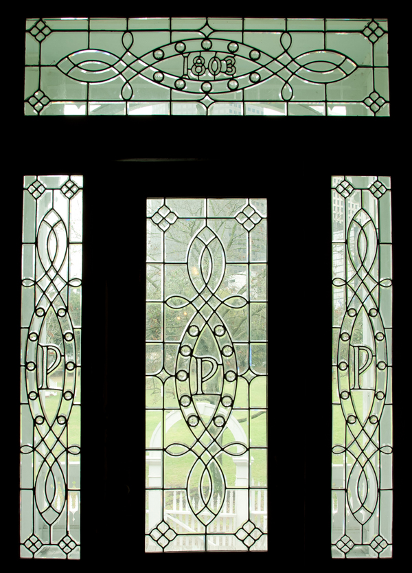 "Beautiful leaded glass front door incorporate the house's original street address, 1803, and the initial ""P"" for Pillot."