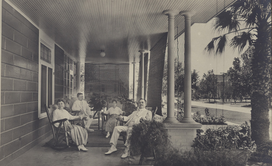 Image: Brothers Henry and Grover Staiti with their wives, sisters Odelia and Leah Reisner, on the front porch of the Staiti house ca. 1918.