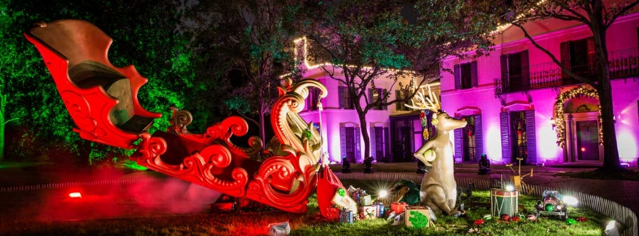The Christmas Village at Bayou Bend house tour begins on the front lawn, where Santa has crash-landed his 25-foot sleigh, guarded by a nine-foot-tall Rudolph. Dazzling Christmas light displays illuminate the bridge, gardens, and exterior of the Bayou Bend house and cottage, creating a magical effect you and your family won't soon forget. Courtesy of MFAH Archives.