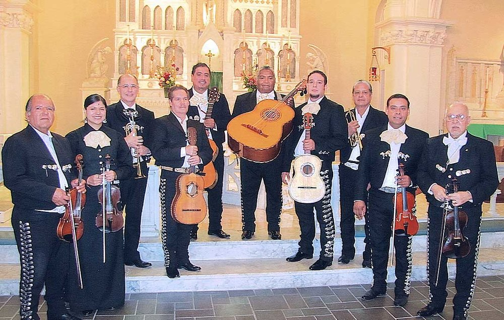"Mariachi Norteno Founded in 1959 by guitarron virtuoso Jesse Escareno, the Mariachi Norteño ensemble brought the mariachi folk Mass called la Misa Panamericana to the U.S. from Mexico. And they keep bringing it, every week, to a packed congregation at the St Joseph – St Stephen Church in the Sixth Ward. Holding his beloved guitarron, a six-string bass guitar developed in 16th-century Spain, Escareno said, ""I taught myself to play,"" before looking heavenward and acknowledging, ""Maybe He helped me."""