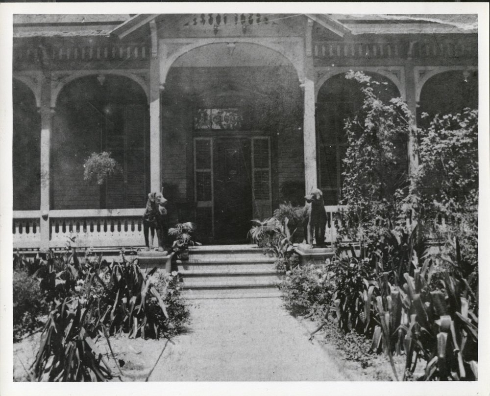 historic photo of the pillot house with the dogs standing guard.